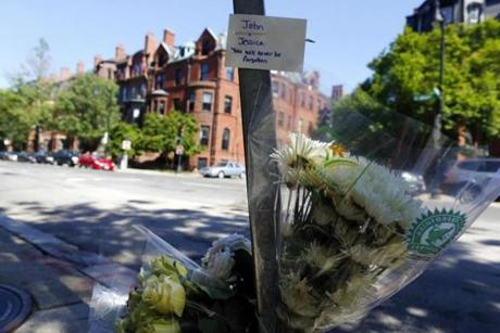 Mourners on Sunday left  flowers and a note to the couple near the site on Beacon Street.